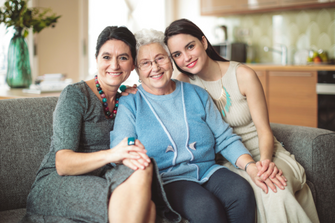 Mother and daughters sitting together | Cancer Hospital in Missouri and Kansas